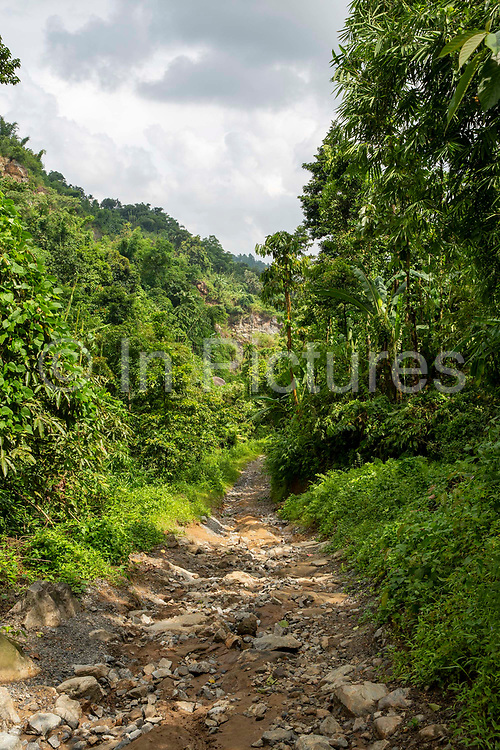 View down a steep rugged path towards a remote village on 21st September 2018 in Umling, Ri Bhoi, Meghalaya, India.