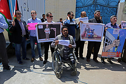 May 3, 2017 - Gaza City, Gaza Strip, Palestinian Territory - Palestinian Journalists hold banners during a protest calling for stop the Israeli violence against journalists on the occasion of World Press Freedom day in front of the high commissioner for human rights headquarters, in Gaza city ON May 03, 2017  (Credit Image: © Ashraf Amra/APA Images via ZUMA Wire)