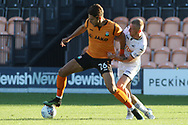 Dan Sweeney of Barnet (L) fends off Oli McBurnie of Swansea city (R). Pre-season friendly match, Barnet v Swansea city at the Hive in London on Wednesday 12th July 2017.<br /> pic by Steffan Bowen, Andrew Orchard sports photography.