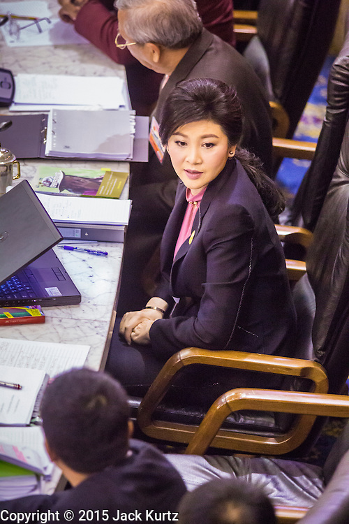 """09 JANUARY 2105 - BANGKOK, THAILAND: YINGLUCK SHINAWATRA, former Prime Minister of Thailand, listens to the government case against her during her impeachment trial in the National Legislative Assembly. Thailand's military-appointed National Legislative Assembly began impeachment hearings Friday against former Prime Minister Yingluck Shinawatra. If she is convicted, she could be forced to stay out of politics for five years. During her defense, Yingluck questioned the necessity of her impeachment, saying, """"I was removed from office, the equivalent of being impeached, three times already, I have no position left to be impeached from."""" A decision on her impeachment is expected by the end of January.    PHOTO BY JACK KURTZ"""