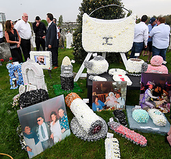 © Licensed to London News Pictures. 21/04/2018. London, UK. Floral tributes at the burial of traveller 'Queenie, Elizabeth Doherty at Kensal Green Cemetery in west London, following a funeral service in Cobham, Surrey. Elizabeth Doherty, whose son Paddy Doherty is known for appearing on My Big Fat Gypsy Wedding and winning Celebrity Big Brother 8, died of a heart attack earlier this month. Paddy Doherty claimed his mother has died of a 'broken heart' following the death of her husband almost a year ago. Photo credit: Ben Cawthra/LNP