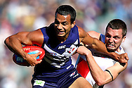 PERTH, AUSTRALIA - JULY 07:  Jarryn Geary of the Saints tackles Danyle Pearce of the Dockers during the round 15 AFL match between the St Kilda Saints and the Fremantle Dockers at Patersons Stadium on July 7, 2013 in Perth, Australia.  (Photo by Paul Kane/Getty Images)