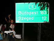 Migrants break from a police corden close to the Hungarian and Serbian border town of Roszke, Hungary, September 8 2015. The UN's humanitarian agencies are on the verge of bankruptcy and unable to meet the basic needs of millions of people because of the size of the refugee crisis in the Middle East, Africa and Europe, senior figures within the UN have told the media.
