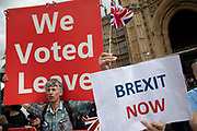 Leave campaign Brexit protesters in Westminster on the day that Parliament reconvenes after summer recess to debate and vote on a bill to prevent the UK leaving the EU without a deal at the end of October, on 3rd September 2019 in London, England, United Kingdom. Today Prime Minister Boris Johnson will face a showdown after he threatened rebel Conservative MPs who vote against him with deselection, and vowed to aim for a snap general election if MPs succeed in a bid to take control of parliamentary proceedings to allow them to discuss legislation to block a no-deal Brexit.