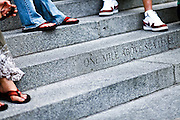 """SHOT 8/13/09 2:06:45 PM - The words """"One mile above sea level"""" mark the spot orginally thought to be 5,280 feet (or one mile) above sea level on the steps of the Colorado State Capitol. The official elevation of Denver is measured outside the west entrance to the building, where the fifteenth step is engraved with the words """"One Mile Above Sea Level."""" From this step, around dusk, a magnificent view of the sun setting behind the Rocky Mountains can be taken-in at 5,280 feet (1,609 m). A second mile high marker was set in the 18th step in 1969 when Colorado State University students resurveyed the elevation. Finally, in 2003, an even more accurate measurement was made with modern means and the 13th step was identified as being one mile (1.6 km) high where a 3rd marker was installed. Colfax Avenue is the main street that runs east and west through the Denver-Aurora metropolitan area in Colorado. As U.S. Highway 40, it was one of two principal highways serving Denver before the Interstate Highway System was constructed. In the local street system, it lies 15 blocks north of the zero point (Ellsworth Avenue, one block south of 1st Avenue). For that reason it would normally be known as """"15th Avenue"""" but the street was named for the 19th-century politician Schuyler Colfax. On the east it passes through the city of Aurora, then Denver, and on the west, through Lakewood and the southern part of Golden. Colloquially, the arterial is referred to simply as """"Colfax"""", a name that has become associated with prostitution, crime, and a dense concentration of liquor stores and inexpensive bars. Playboy magazine once called Colfax """"the longest, wickedest street in America."""" However, such activities are actually isolated to short stretches of the 26-mile (42 km) length of the street. Periodically, Colfax undergoes redevelopment by the municipalities along its course that bring in new housing, trendy businesses and restaurants. Some say that these new developments detract from the chara"""