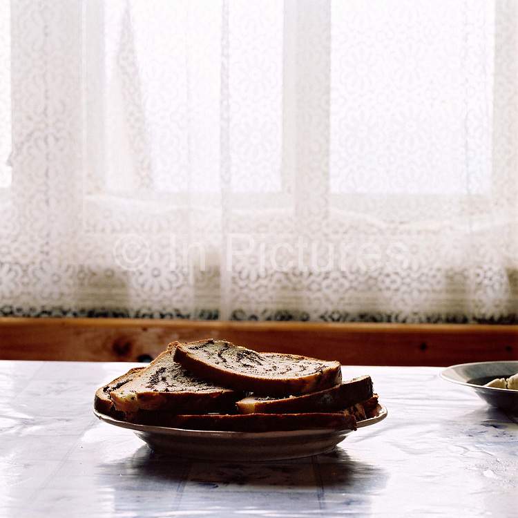 Slices of traditional cake on a plate in a peasant farmer's kitchen in the Carpathian Mountains, Romania