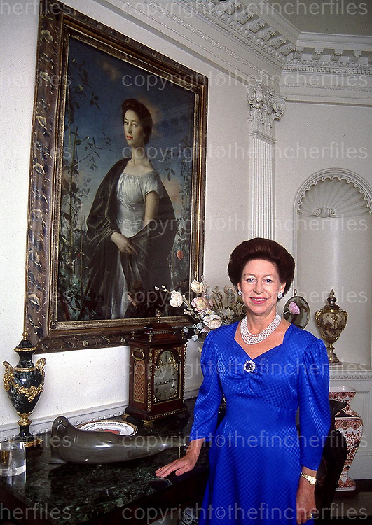 Princess Margaret seen in her apartment at Kensington Palace, London in 1988. In the background is a portrait of the Princess by Italian artist Pietro Annagoni. Photographed by Jayne Fincher