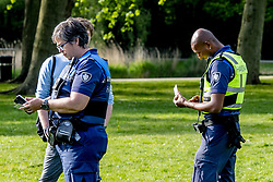 Pressed the police in the Vroesepark and enforcement boa requesting everyone to leave some people receiving fines for corona rules; one and a half meters society ban on gathering; crowded crowded King's Day, Rotterdam, Netherlands on April 27, 2020. Photo by Robin Utrecht/ABACAPRESS.COM