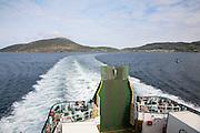 Ship's wake in water ferry leaving Castlebay, Barra, Outer Hebrides, Scotland, UK