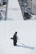 Reshaping the kicker during the mens snowboard big air qualification at the Pyeongchang 2018 Winter Olympics on February 21st 2018, at the Alpensia Ski Jumping Centre in Pyeongchang-gun, South Korea