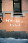 Satirical graffiti outside the Faculty of Architecture, Genoa University that reads in translation Frank Gehry is shit, Genoa, Italy.