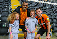 Hull City's Josh Magennis and Callum Elder celebrate with family members after the match<br /> <br /> Photographer Alex Dodd/CameraSport<br /> <br /> The EFL Sky Bet League One - Hull City v Wigan Athletic - Saturday 1st May 2021 - KCOM Stadium - Kingston upon Hull<br /> <br /> World Copyright © 2021 CameraSport. All rights reserved. 43 Linden Ave. Countesthorpe. Leicester. England. LE8 5PG - Tel: +44 (0) 116 277 4147 - admin@camerasport.com - www.camerasport.com
