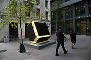 Sculpture in the City on July 17th 2017 in the City of London, England, United Kingdom. Each year, the critically acclaimed Sculpture in the City returns to the Square Mile with contemporary art works from internationally renowned artists in a public exhibition of artworks  open to everyone to come and interact with and enjoy. Black Shed Expanded by Nathaniel Rackowe 2014-2016.
