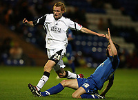 Photo: Rich Eaton.<br /> <br /> Peterborough United v Swansea City. Johnstone's Paint Trophy. 31/10/2006. Shane Huke of Peterborough #18 tackles Shaun MacDonald of Swansea
