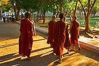 Buddhist monks walking outside Kuthodaw Pagoda, Mandalay, Burma