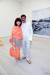 JAMES CAAN and his wife AISHA at the BRIC art sale preview (Brazil, Russia, India & China, the acronym BRIC here refers to the burgeoning contemporary art practices within these four countries.) organised by Phillips de Pury & Company at The Saatchi Gallery, London on 17th April 2010.