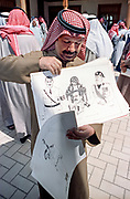 A Kuwaiti artist shows off anti-Iraq drawings he plans on presenting the Emir of Kuwait Sheikh Jaber al-Ahmad al-Sabah following the liberation March 16, 1991 in Kuwait City, Kuwait. After four days of fighting, all Iraqi troops were expelled from Kuwait, ending a nearly seven-month occupation of Kuwait by Iraq.
