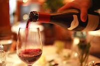wine steward pouring red wine at Restaurant Pierre Gagnaire, Paris