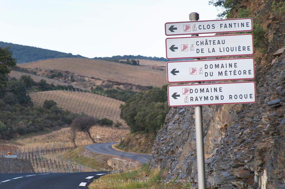Clos Fantine, Chateau de la Liquiere, Domaine du Meteore, Domaine Raymond Roque. Winding road and vineyard. Near La Liquiere village. Faugeres. Languedoc. France. Europe.