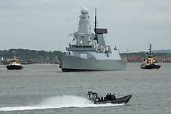© Licensed to London News Pictures. 20/05/2016. HMS Duncan approaching the QEII Bridge. Type 45 Destroyer HMS Duncan has arrived in London for a port visit. The 152 metre long Royal Navy ship is visiting London for the time. She was commissioned in to the Navy in 2013. Credit: Rob Powell/LNP