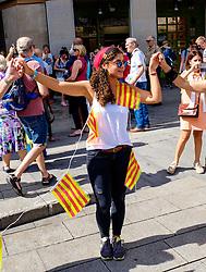A Catalan girl dancing the Sardana, a traditional dance  in the Palau de la Generalitat de Catalunya near Barcelona Cathedral<br /> <br /> (c) Andrew Wilson | Edinburgh Elite media