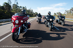 Motorcycle Racer Carey Hart riding a red 2017 Indian Chieftain Elite with Bagger Magazine's Morgan Gales and AJ Smyth of Indian (r) 2017 riding Indian Chieftain Limiteds on I-95 during Daytona Beach Bike Week. FL, USA. Friday March 10, 2017. Photography ©2017 Michael Lichter.