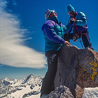 Mountaineers Mike Rufer & Jan-Marc Baker reach summit of Mount Gayley in the Palisades region of California's Sierra Nevada.