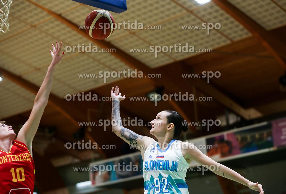 Kristina Rakovic of Montenegro vs Nika Baric of Slovenia during friendly basketball match between Women National Teams of Slovenia and Montenegro, on May 21, 2021 in Arena Tri Lilije, Lasko, Slovenia. Photo by Vid Ponikvar / Sportida