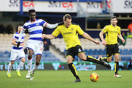 Burton Albion defender Ben Turner (6) tackling Queens Park Rangers forward Idrissa Sylla (40) during the EFL Sky Bet Championship match between Queens Park Rangers and Burton Albion at the Loftus Road Stadium, London, England on 28 January 2017. Photo by Matthew Redman.
