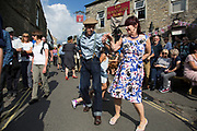 Grassington 1940s Weekend event held annually in the village Grassington in the Yorkshire Dales, England, UK. Local people join in with mass re-enactment commemorating World War II spirit with military and vintage clothing, military vehicles and dancing. Couple dancing.