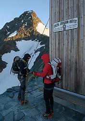 THEMENBILD - Großglockner im Sommer. das Bild wurde am 12. August 2012 aufgenommen. im Bild Bergsteiger bereiten sich auf der Erzherzog Johann Hütte, auch Adlersruhe genannt, im ersten Sonnenlicht auf die Besteigung des Großglockners vor // THEME IMAGE FEATURE - Großglockner at Summer. The image was taken on august, 12, 2012. Picture shows Alpinists preparing for Grossglockner ascent at the first sunlight, AUT, EXPA Pictures © 2012, PhotoCredit: EXPA/ M. Gruber