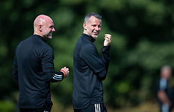 CARDIFF, WALES - Monday, August 31, 2020: Wales' manager Ryan Giggs (R) and assistant coach Robert Page watch an Under-21 training session at the Vale Resort ahead of the UEFA Under-21 Championship Qualifying Round Group 9 match between Bosnia and Herzegovina and Wales. (Pic by David Rawcliffe/Propaganda)