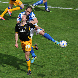 Bristol Rovers' Chris Beardsley wins the ball from Mansfield Town's Ollie Palmer- Photo mandatory by-line: Alex James/JMP - Mobile: 07966 386802 03/05/2014 - SPORT - FOOTBALL - Bristol - Memorial Stadium - Bristol Rovers v Mansfield - Sky Bet League Two