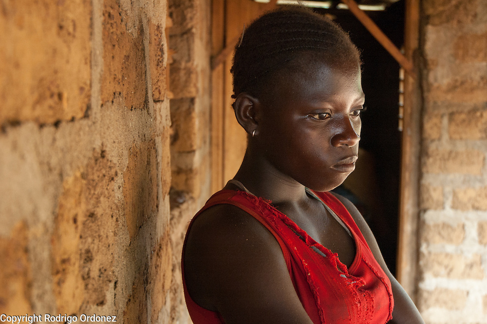 Emma, 13, poses for a photograph. In December 2010, she fled post-election violence in her home village, in western Côte d'Ivoire. She has been separated from her family for more than four months. She is temporarily living with a host family in Danané until her parents are found.