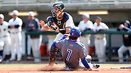 CARY, NC - MARCH 04: UMass Lowell's Chris Sharpe (7) slides across home plate, beating the tag by Notre Dame's Connor Power (behind), and scoring a run. The University of Massachusetts Lowell River Hawks played the University of Notre Dame Fighting Irish on March 4, 2017, at USA Baseball NTC Stadium Field in Cary, NC in a Division I College Baseball game, and part of the Irish Classic tournament. UMass Lowell won the game 8-0.