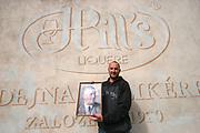 Jindrichuv Hradec/Tschechische Republik, Tschechien, CZE, 31.08.2007: Das Unternehmen Hill¥s Liquere S.R.O. wurde 1920 von Albin Hill  gegr¸ndet. Die Tradition wurde 1947 von Radomil Hill weitergef¸hrt - heute wird das Unternehmen von seiner Tochter Ilona Musialova geleitet. Hill¥s Absinth wird in der s¸dbˆhmischen Stadt  Jindrichuv Hradec produziert. Tomas Hill vor der Familien Brennerei mit dem Portrait des Firmengr¸nders Albin Hill.<br /> <br /> Jindrichuv Hradec/Czech Republic, CZE, 31.08.2007: Albin Hill established Hill's Liguere in 1920. He started out as a wine wholesaler and soon after he began producing his own liquor and liqueurs. In 1947 his son Radomil Hill continues this tradition and today his daughter Ilona Musialova is leading the company. Her son Tomas Hill with a portrait of Albin Hill in front of the family distillery.