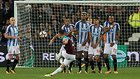 Football - 2017 / 2018 Premier League - West Ham United Vs Huddersfield Town<br /> <br /> Aaron Cresswell (West Ham United)  tries his luck with a free kick at the London Stadium<br /> <br /> COLORSPORT/DANIEL BEARHAM