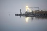 The old lighthouse of Oostmahorn at the Lauwersmeer at night, moonlit // Het oude vuurtorentje van Oostmahorn 's nachts bij maanlicht.