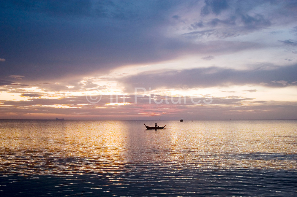 Fishing at night at sunset over Klong Nin beach, Koh Lanta. This quiet beach half way down the west coast of the island is a real retreat from the busier beaches in the north of the island. The further south you go, the quieter they become. Sunsets are always stunning.