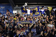AFC Wimbledon fans celebrate their teams 1-0 win after the final whistle. Skybet football league two play off semi final, 1st leg match, AFC Wimbledon v Accrington Stanley at the Cherry Red Records Stadium in Kingston upon Thames, Surrey on Saturday 14th May 2016.<br /> pic by John Patrick Fletcher, Andrew Orchard sports photography.