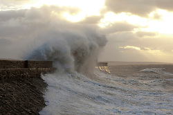 © Licensed to London News Pictures. 02/11/2020. Porthcawl, Bridgend, Wales, UK. Strong winds and large waves batters the small Welsh seaside resort of Porthcawl in Bridgend, UK. Photo credit: Graham M. Lawrence/LNP