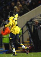 Photo: Paul Greenwood.<br />Bolton Wanderers v Arsenal. The FA Cup. 14/02/2007. Arsenal's Emmanuel Adebayor dedicates his goal to the Arsenal bench