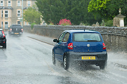 © Licensed to London News Pictures. 16/06/2020. Builth Wells, Powys, Wales, UK. Motorists drive through heavy surface water during a thunderstorm in Builth Wells, Powys, UK. Thunderstorms and heavy rain hit Powys, Wales, UK. Photo credit: Graham M. Lawrence/LNP