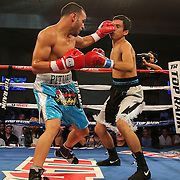 ORLANDO, FL - OCTOBER 04: Christopher Diaz of Puerto Rico (L)  catches Francisco Camacho of Mexico with a left jab during a professional featherweight boxing match at the Bahía Shriners Auditorium & Events Center on October 4, 2014 in Orlando, Florida. (Photo by Alex Menendez/Getty Images) *** Local Caption *** Christopher Diaz; Francisco Camacho
