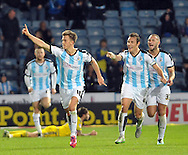 Emyr Huws (left) of Huddersfield Town celebrates scoring the equaliser against Nottingham Forest during the Sky Bet Championship match at the John Smiths Stadium, Huddersfield<br /> Picture by Graham Crowther/Focus Images Ltd +44 7763 140036<br /> 24/09/2015