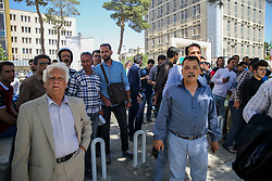 Iranian's watch the operation outside the Iranian parliament during an attack on the complex in the capital Tehran on June 7, 2017. Photo by Vahabzadeh FarsNews/ParsPix/ABACAPRESS.COM