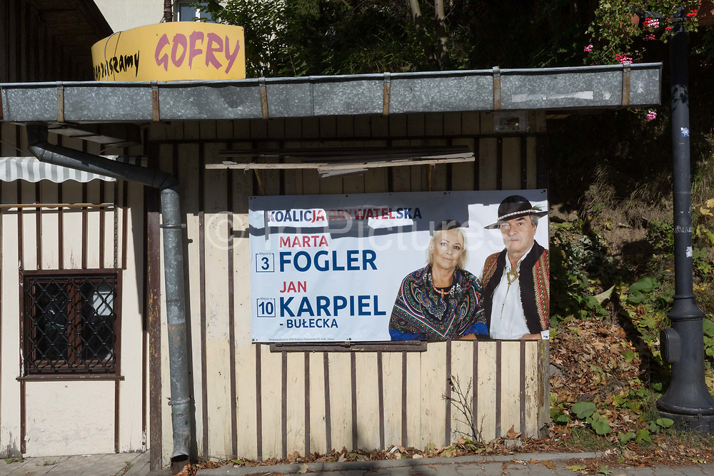 An election poster for Polish political candidates Marta Fogler and Jan Karpiel of the Citizens Coalition, on a residential streets tree, on 21st September 2019, in Szczawnica, Malopolska, Poland. Polands parliamentary elections will be held on 13 October 2019 when all 460 members of the Sejm and 100 senators will be elected. The Sejm of the Republic of Poland is the lower house of the Polish parliament. It consists of 460 deputies elected by universal ballot and is presided over by a speaker called the Marshal of the Sejm of the Republic of Poland.