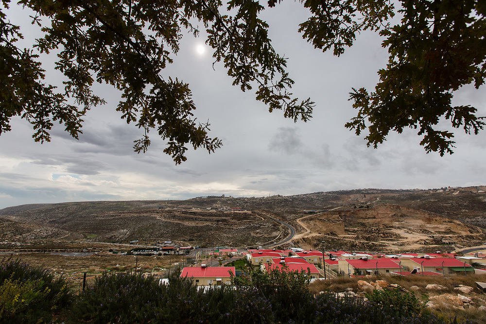 A general view of houses in the West Bank Jewish settlement of Migron and Israel's highway 60, seen from Psagot Winery in the Nachalat Binyamin visitors center, near the Palestinian West Bank city of Ramallah, on November 17, 2015.