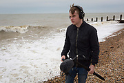 A teenage film student sound man from college in London learns the art of film production on location on the south coast, on 30th April 2017, at Winchelsea, England.