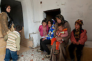Family of Syrian refugees who arrived exhausted on March 10th, 2012 in the village El Fakha, Lebanon, after a bombardment on March 9th, 2012 which destroyed their house in Zahra.
